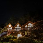 Lodge under the night sky
