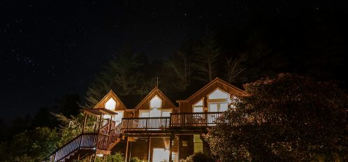 Lodge under the night sky